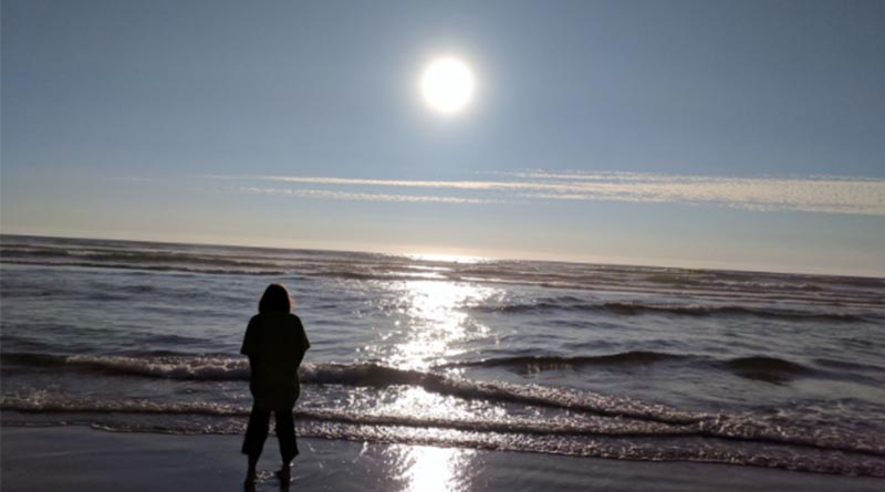 Erysse Elliott in Tillamook, Ore., in 2017. The beaches in Oregon are cold and endless.