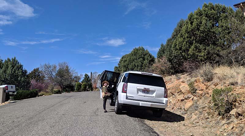 Erysse Elliott loads up her Hertz rental in Prescott, Ariz. Staying entertained on long drives isn't easy, but it's not impossible.