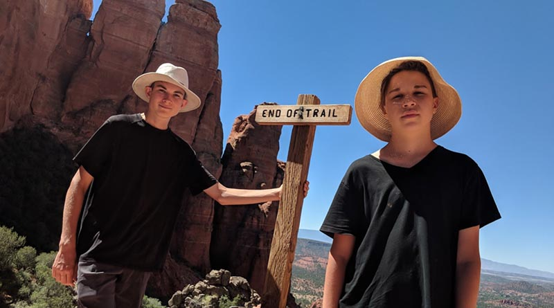 Aren and Iden Elliott at the top of Cathedral Rock in Sedona, Ariz.