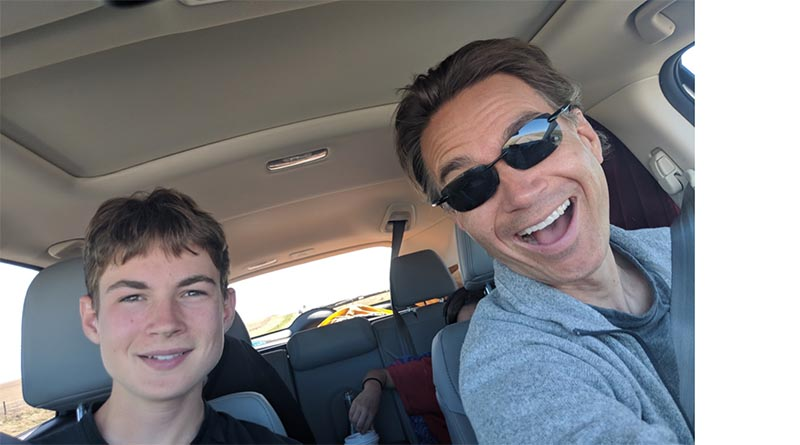 Aren Elliott and the author share a light moment while driving through Colorado in 2018.