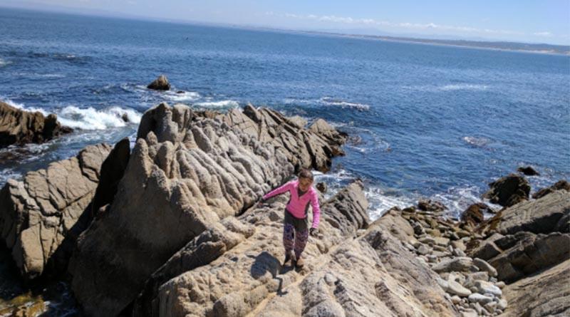Erysse Elliott on the rocks in Monterey, Calif., in 2017.