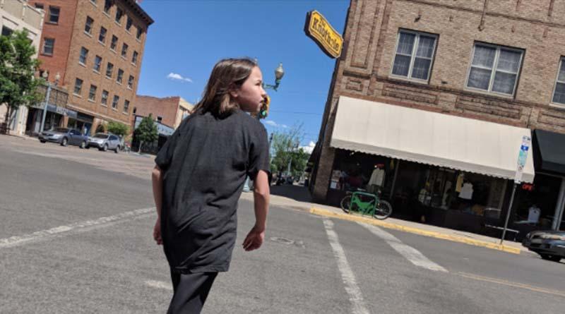 Erysse Elliott crosses a street in Laramie, Wyo. Alas, we saw no tornadoes when we visited.