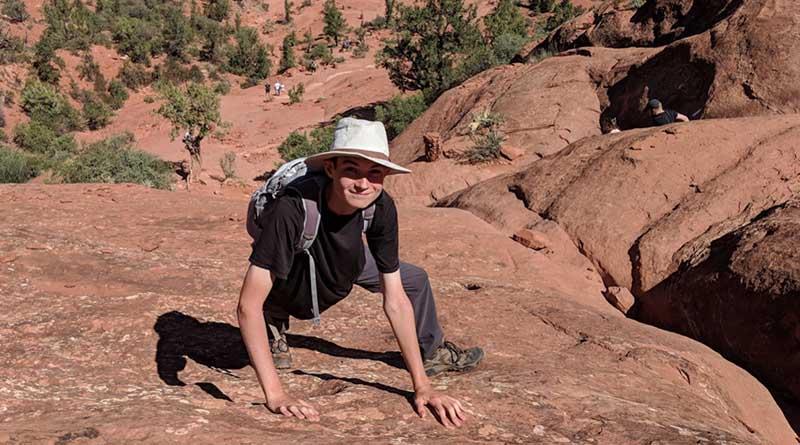 Aren Elliott climbs Cathedral Rock in Sedona, Ariz., in the summer of 2018.