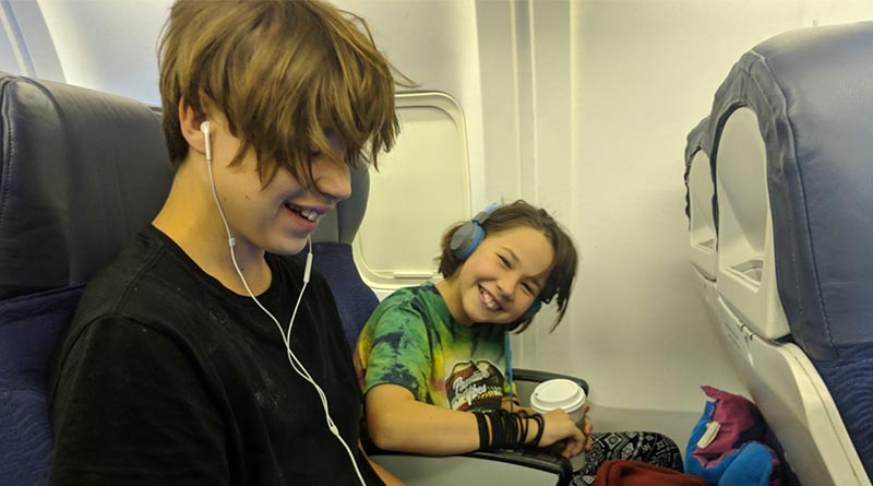 How do I sit with my kids on a plane?