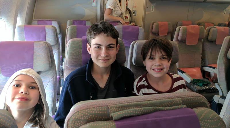 Erysse, Aren and Iden on an Emirates flight to Dubai in 2017.