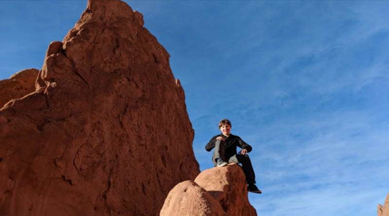 Iden Elliott scales the cliffs in the Garden of the Gods in Colorado Springs, Colo. It looks scary, and it was.