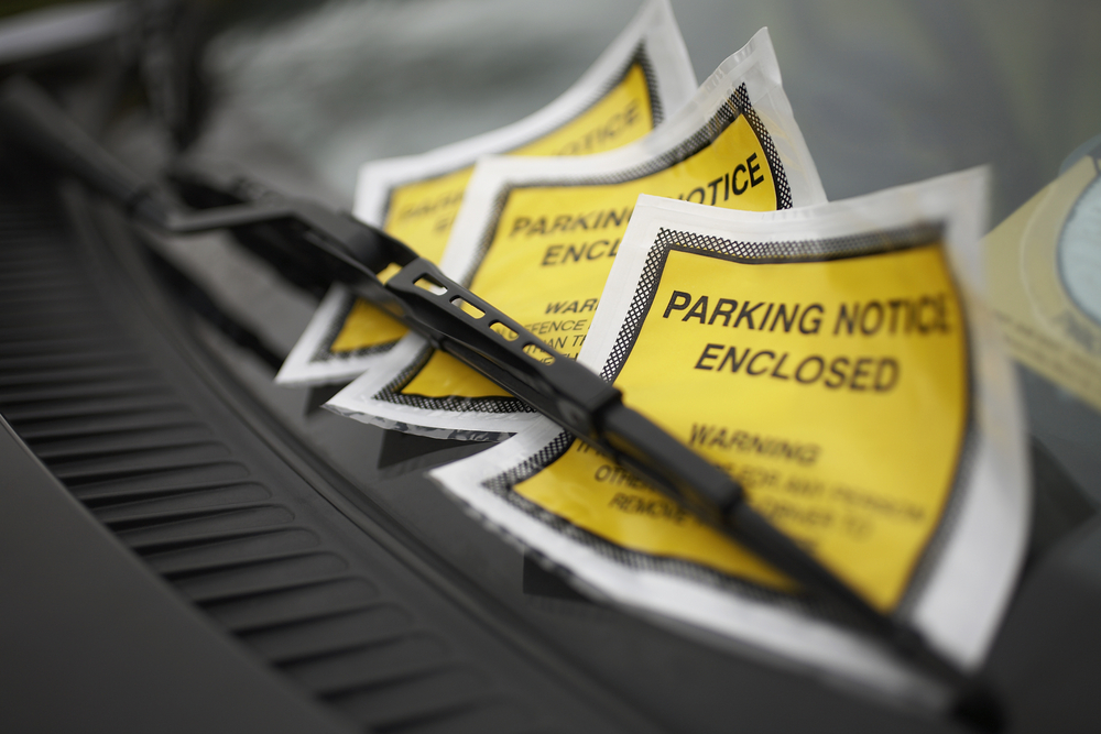 Why won't Econo Lodge pay my parking ticket?