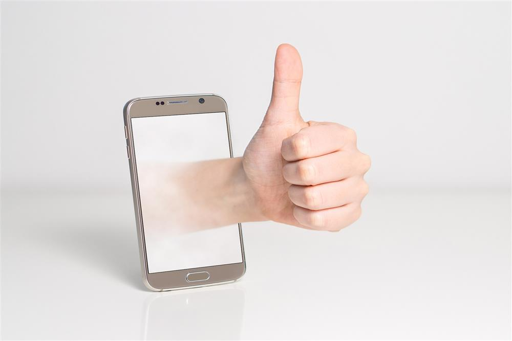 thumb, thumbs up, approve, ok, yes, approved, cleared, good to go, mobile, cell, phone, reward, positive, review, online review, recompense, reciprocity, reciprocal, favor, kind, kindness