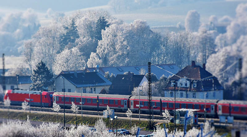 If I'm in Austria, how can I pick up my train tickets in France?
